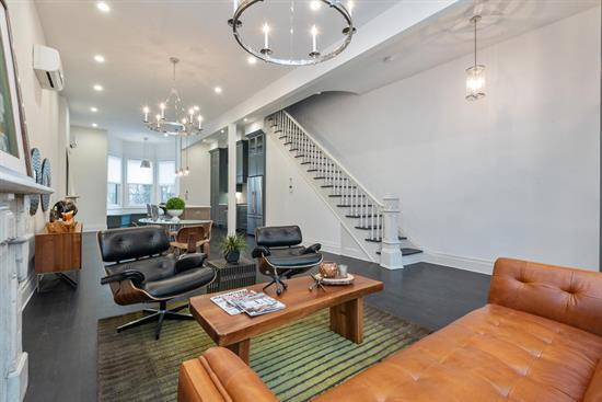 Welcome To This Extraordinary Two-Family Home In The Heart Of Historic Jersey City. Just Shy Of 3, 500 Square Feet, This Spacious Property Has Been Tastefully Renovated From Top To Bottom And Features The Perfect Balance Of Ultra-Premium Amenities And Old World Charm That Dates Back To The Home'S Debut In 1880. As You Step Into The Second Unit Through The Stunning Double Door Foyer, You Will Indulge In Luxe Open-Concept Living As You Travel Through The Living And Dining Room And Into The One-Of-A-Kind Chef'S Kitchen. Premium Amenities Like Sleek Caesarstone Quartz Countertops, High-End Stainless Steel Appliances, And A Cerused Oak Center Island Provide A Stark Contrast To The Nearby Fireplace, Fusing Contemporary Design With Historic Character. Just Past The Island, A Custom Breakfast Nook Sits Beneath Three Spectacular Bay Windows. Upstairs, You'Ll Discover Two Capacious Bedrooms And Two Brand New Baths, All Boasting Ample Natural Light And Exquisite Finishes. One Floor Up Is Where You'Ll Find The Palatial Master Suite, Featuring A Massive Walk-Through Closet, A Spa-Like Bath And An Enormous Soaking Tub Surrounded By Double Vanities And An Oversized Glass Shower. The Final Level Of This Home Boasts A Stunning Roof Deck, Ideal For Entertaining And Relaxing In The Warmer Months. Downstairs In The Garden, Or Rental Unit, You'Ll Find Gleaming 5 White Oak Flooring, A Sundrenched Bedroom, And An Immaculate Bath. The Expansive Kitchen Is Complete With Blue-Gray Custom Cabinetry, A Full Suite Of Stainless Steel Appliances, And Plenty Of Space To Entertain And Dine With Ease. Just Beyond, You'Ll Find A Private Backyard Showcasing A Tiled Patio And Professional Landscape Design.