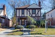 Irresistibly Charming, Warm And Inviting 3 Bdrm, 1 1/2 Bath Tudor Side Hall Colonial. Main Level Boasts Ef, Living Rm W/Fpl, Open Dinning RmW/French Doors To A Sun Drenched Large Entertainers Backyard, Beautiful Eik W/Granite, Powder Rm And Ose, Second Level Has 3 Bdrms, Full Bath W/Tub & Shower. Full Basement , Many Pluses And Updates, Wood Detail Moldings And Hardwood Floors.Steps Away To Public Transportation And NYC Express Bus. Zoned For PS 188.