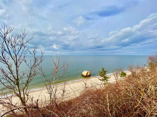 Enjoy ever-changing views of Long Island Sound from this 3 bedroom 2 bath home, or visit your beach below. Beautifully renovated kitchen, dining room, sunroom, living room - plenty of room for everyone to relax. Stairs to the beach. Peace and quiet for your summer vacation.