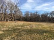 Pristine, large vacant lot in the East Moriches Historical District. Your opportunity to build your dream home on this cleared flag lot. Close to Main Street shops and restaurants and Town of Brookhaven Boat Ramp. Adjacent to Town of Brookhaven preserve.