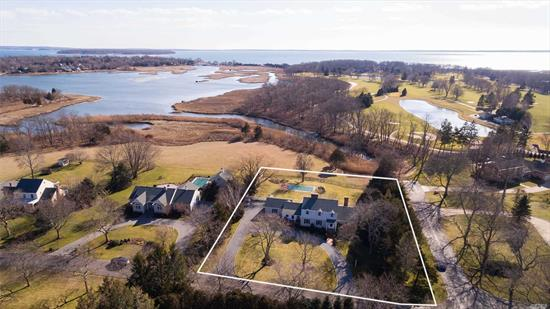 Beautifully updated 4 bedroom Dutch Colonial with water views in coveted Fairway Farms. On shy acre w/ views of NFCC's 16th fairway in distance and Gunite Pool on backdrop of 12 acre preserve. Stand-outs are the Chef's Eat-In Kitchen which opens to great room and water views, Recessed Panels all around, Fabulous Master Suite on 1st floor, 5 fireplaces and stunning views of West Creek. Wonderful balance of end of the block quiet while close to village, golf, marinas and library. Spectacular Spot