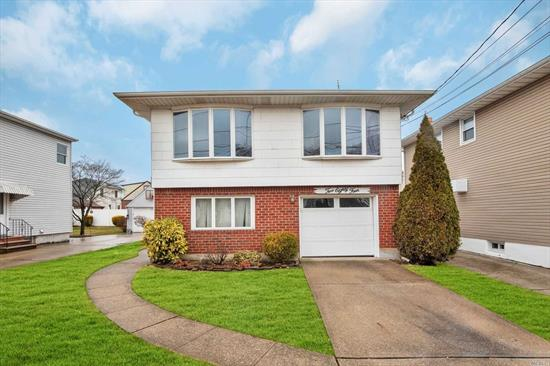 custom built hi-ranch with all large rooms. Tons of windows allows lots of light into this large formal dining room, great eat-in-kitchen and living room. Hardwood floors thru-out. main floor bedroom and family room, attached garage, in-ground sprinklers, sits midblock on a quiet street