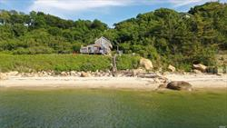 Magnificent Location - A unique platau just high enough but not to many steps down too your own personal private beach. 1.3 Acres with a hugh 268' of beachfront that has 2 jetties and some great bolders to play or fish around. Currently a summer home only - no heat. Can be used as such or made year round ! Panoramic viwes of both sunrises and sunsets - its amazing !!!