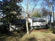 Live Your Life in Serenity in This Expanded Split Level Home on a Quiet Tree Lined Street Part of the LIttle Neck Peninsula. This 4 Br 3 Bth Home Offers Spacious Rms w/ HW Floors, Exp Lg Kitchen Leading to a Screened in Porch, Sun-Lit Atrium, Master Br w/Bath & Adjoining Br/Office. Lg Family Rm w/FP, Built in Cabinetry, Full Bath and More. Newer Roof, Boiler, Oil Tank and Updated Bathrooms.Generator Part of The Plaisance Beach Assoc. w/ Private Beach, Dock&Mooring On Npt Harbor. Taxes Grievable!!