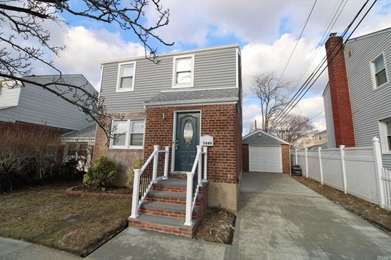 Totally Renovated}, 2 Huge Bedroom Colonial, 2 Full Bath, Eat In Kitchen With Quartz Counter Tops, Stainless Steel Appliances, Porcelain Tiles, Formal Living Room, Formal Dining Room With Gleaming State Of The Art Hardwood Floors Throughout, Central Heating System, Laundry Room, Full Finished Basement W/High Ceiling, 1 Car Detached Garage, Over Sized Yard.