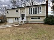Mint Oversized Hi-Ranch, 4 Bedrooms, 2 Full Baths, 1.5 Garage, Den with stone fireplace, Sliders that lead to a large deck great for entertaining. Move in ready!!!