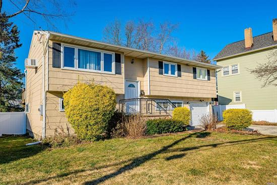 Lovely maintained and recently renovated Hi Ranch with park like grounds 75x100. Home features 4 Br's and 2 full baths with an outside separate entrance for the 1st floor. Possible mother and daughter with proper permits. Attached garage with private driveway. Close to LIRR Babylon Train line and 40 minutes from Queens.
