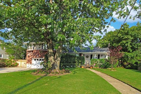 Sun-filled fully renovated balcony split, deep property boasts a resort like backyard with 2 decks, brick patio, hot tub that seats 8 people and outdoor speakers for enjoying your favorite music..2 NEW bathrooms, 6 yr old Roof, insulation & siding, Updated EIK has new top of the line appliances, CAC, IGS, Alarm. Truly a Pristine Turn Key home in RVC SD #21. +Express LIRR to Penn Sta. ++low taxes +++ Full Basement
