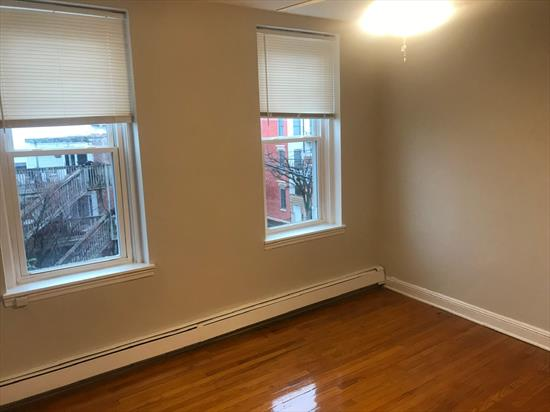 Welcome home to this awesome 1BR apartment at an affordable price! This gorgeous unit features a fabulous floor plan with large rooms (NOT A RAILROAD STYLE APARTMENT! ).  Come make this well maintained and professionally managed building your new home! Apartment has just been freshly painted and features a large (approx. 8ft X 10 ft) eat-in kitchen, large living room and bedroom (each approx. 13ft X 12ft), great closet space and just refinished, gleaming hardwood floors. Brand new ceiling fans/light fixtures in living room and bedroom. Very bright and airy with high ceilings. Located on lovely downtown  Jefferson Street. Close to Light Rail, PATH, supermarkets. parks, cafes and waterfront.