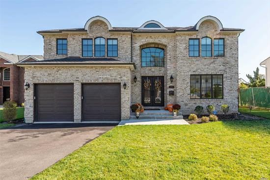 Newly Custom built Brick Colonial in Roslyn, Herricks school district. No expense spared in this home. Features 5 bedrooms 5.5 baths.Beautiful 2 story entrance foyer with custom iron railing staircase. Gourmet Kitchen with granite counter tops , top of the line stainless steel appliances, large family room, doors to a park like backyard.Large master suite with walk in closets , master bath with double sink tub and shower, 3 additional large bedrooms and 3 bths upstairs. Many upgrades!