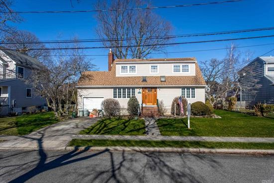 Beautiful expanded 4 bedroom cape, Living Room w/gas Fireplace, Formal Dining Room, Eat in Kitchen with sliding glass doors onto large deck. Appeals to the senses. Beautiful curb appeal with new front door. Full finished basement with laundry room. Plenty of closets.