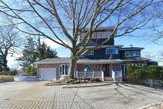 Immaculate colonial with Long Island Sound water views from the Master! This property has been completely renovated and features 4 large bedrooms and 3.5 baths. Built with a large open concept perfect for entertaining. Mint is an understatement!