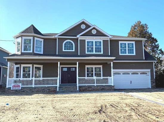 Brand-New Custom Center-Hall Colonial Being Built On RARE 11, 100+ SqFt of prop BACKING TO MASSAPEQUA PRESERVE! *INTERIOR Pics Are Of Same Model Home By Same Quality Builder Of 30+ Yrs.* March Est. Completion-- add your finishing touches now! Approx 3500 Total Int Sq Ft Of Open Flr Plan (+F.Porch +Huge Bsmt w/O-S-E) Expertly Designed & To-Be-Finished W/Utmost Quality Of Craftsmanship. Designer Baths, Custom Kit, Pella Wdws, Intricate Trimwork Throughout, 1st Flr Bdrm/Office & Fbath, 2-Car Gar, ++!