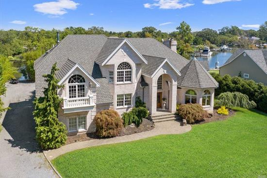 Spectacular 5, 000 sq ft custom built home w/water views from every room . Gourmet Eat in kitchen w/granite countertops and huge island, sunken family room w/floor to ceiling windows and imported marble fireplace. Master suite w/custom walk in closets and Fireplace, waterviews from every room. Deep canals to accomodate yachts.