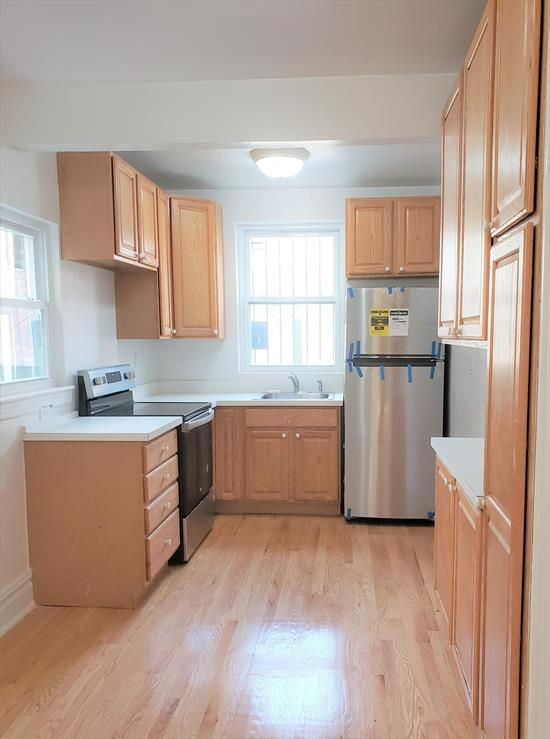 Charming and Spacious Newly Renovated Apartment for Rent. Features Large Living Room w/High Ceilings, Eat-In-Kitchen w/Stainless Steel Appliances, 1 Bedroom w/ Walk-In-Closet, Small Nook Perfect for a Desk, Bathroom w/Subway Tiles, Beautiful Wood Floors Throughout, Lots of Storage, Front Porch and Shared Use of Yard. Parking Available for Additional Fee. Conveniently Located to 7 Train, Main Street, Buses, and All Major Highways.