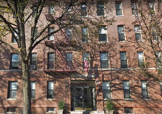 Beautiful Apartment in Pre-War Tudor Style Building. Features, Living Room, Eat-In-Kitchen, 2 Bedroom and 1 Full Bath. Cathedral Ceilings, Lots of Windows and Wood Floors Throughout. Coin-Operated Laundry Room. Inviting Rear Courtyard with Table and Chairs for Your Relaxation. Convenient to Auburndale & Broadway LIRR Station, Buses and Shopping. Truly a Must See!