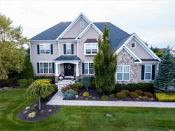 Custom Built Colonial with True Open Concept Living. Maintained to Perfection Inside and Out Gleaming Hardwood Floors Throughout. This 12 Room Beauty Has It All; Expansive Master Bedroom Suite, Den, Library, Sunroom, Media Room, 3000sqft Paver Patio, Heated In-Ground Pool, 3 Car Attached Garage