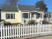 White Picket Fence! Vaulted Ceilings, move-in condition, single family home in incredibly desirable waterfront-marina community. Near Manorhaven town, fine dining, shopping, attend Top Rated PW Schools, N-23 Bus to LIRR and much more!