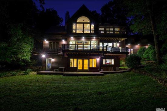 Custom built builders own tranquil Vermont style chalet w/open flr plan-white oak flrs, custom wd banister , moldings, gourmet granite eik, 2 fpl's, cent air, cent vac, lrg master suite w/balcony, bath w/marble flrs, marble count tps, sauna, jaczzi, steam showr,  wd flrs, tile flrs, 5 zne gas heat, new roof, huge wrap around deck, walk out basement-Walls of glass bring in the sunlight & all the beauty of nature.