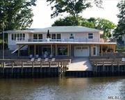 Spacious waterfront in Gardiner's Bay Estates with private dock and direct access to Bay.
