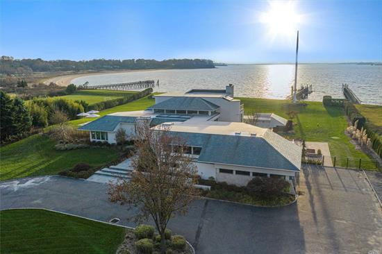 Magnificent Waterfront Contempory with Technicolor Sunsets w/Manhattan Skyline, 270 feet of Sandy Beach front on Half Moon Beach with Dock.