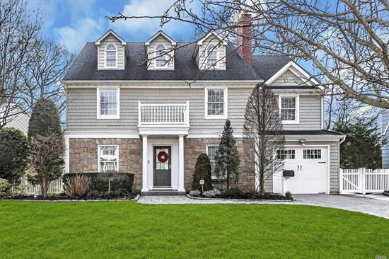 Heart of Merrick Woods! Stunning, Custom 4 bdrm 2 1/2 bth Colonial! State of the Art EIK, oversized center Island w/Calacatta Gold Marble, Wolf Stove, Sub Zero Fridge, wine fridge, Bosche Dishwasher, Formal DR w/gas frplace & built-ins, Den w/gas frplce, Crown Moldings, Hardwood Flrs. Master Suite w/separate office, Huge Master Bth, 3 bdrm, Full Bth, Radiant heat in upstairs baths, Storage Galore, Fin. Bsmt! Whole house water filtration, Close to LIRR, Approx. 40 min express to Penn!! Low Taxes!