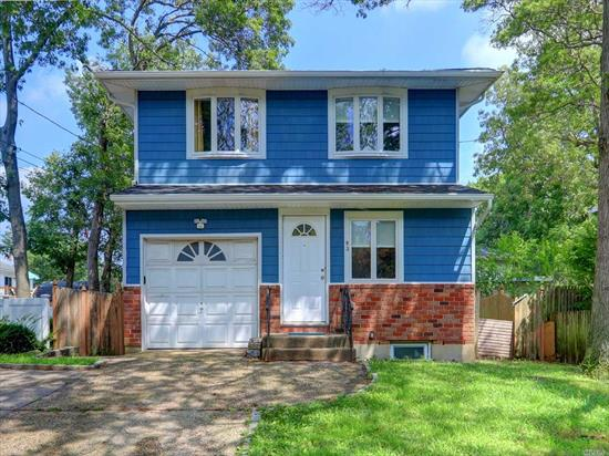 Beautifully Re-modeled 4 Bedroom, 2 Bath Colonial with One Car Garage & Finished Basement. Features Open Floor Plan With Gorgeous Kitchen, SS Appliances, Anderson Windows and More. Decorated to Perfection. Don't Miss it! Will Not Last!!