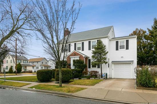 Beautiful Colonial Brick Entrance and Center Hallway, Huge Living Room with Fireplace, Formal Dining Room, Manicure Lawns with Fenced-In Side Yard with In-Ground Sprinklers. Close Green Acres Shopping Mall, Schools, Houses of Worship & The LIRR Station. Total Taxes Include Village