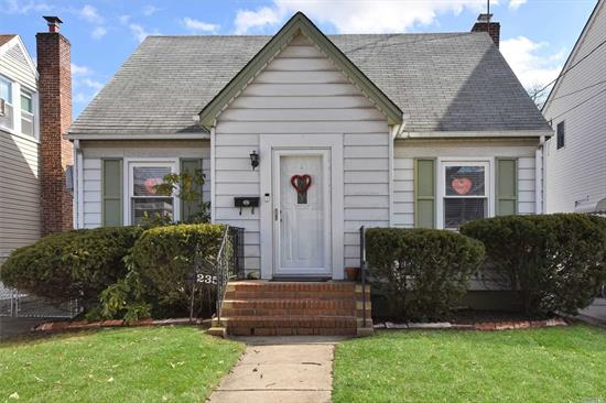 Charming Cape with 2 Bedrooms, (was 3), Living Room, Dining Room, New Full Bath, and Eat in Kitchen. Roof was done 2008, New Gas Boiler and Hot Water Heater, Hardwood Floors, Full Basement and Private Yard with Garage