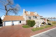 Spacious Expanded Cape Style w/ 3 Bedroom, 2 Updated Bathroom on ENORMOUS park like grounds- Living room,  Dining Room, Eat in Kitchen- Den/Office , Laundry/ Office(possible 4th bedroom) - Smack on the water!! Direct East Exposure - Spectacular SUNRISES!- Boat Launch & Pier, Proposed Float & 6 Boat slips . 2 Waterview Decks.. Full finished (3 rooms) basement, Attached 2 Car Garage. Bosch Heating gas wall mount, baseboard heat, architectural roof shingles,
