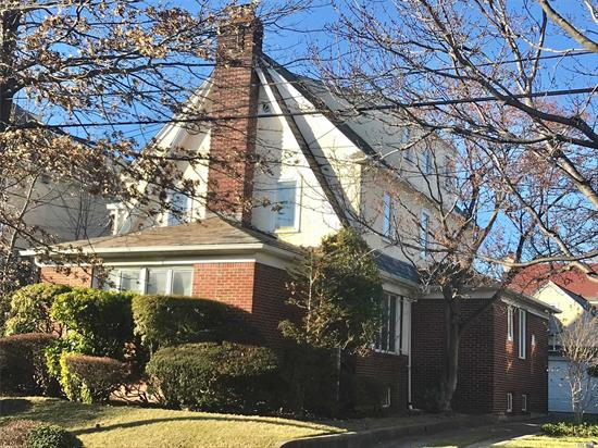 Detached Brick/Stucco South Facing Central Hall Colonial Home On One of The Best Streets of Cord Meyer, 50X100 Lot, 5 BR, 3.5 Baths, 2 Large Porches, Large Living Room w/ Wood Burning Fire Place, Florida Room, Full Fin Basement w/Separate Entrance, New Boiler, C/A/C,  close to E, F express trains and LIRR, P.S. 196