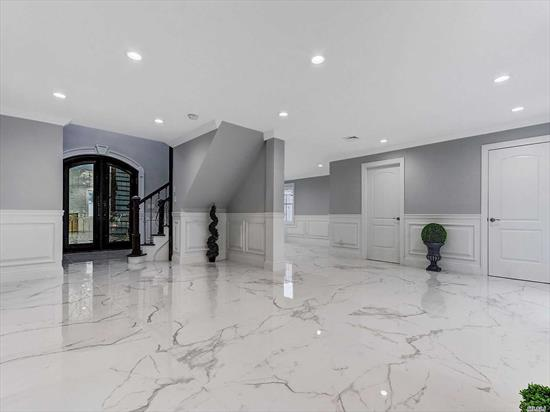 Welcome To This Spectacular New Remodeled, 4 Bedrooms, 3 Full Baths,  Center Hall Colonial That Nests In Prime South Merrick, Award Winning School District #25, 2 Story Open Foyer With Elegant Staircase, Custom Mill Work, Designer Gourmet Kitchen With Stunning Quartz Countertops, High End Appliances, Huge Island With Wine Fridge, Gorgeous Radiant Heated Floors, Stone Faced Gas Fireplace, Master Suite with Walk In Closet and Jetted Tub, Brand New Gas Boiler And Electric,  Wrought Iron Front Door.