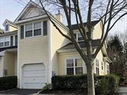 Beautiful end unit condo located in gated community of Windcrest. Hardwood floors through first floors Cathedral ceilings. Eat in kitchen with Corian counter tops and stainless appliances. Master bedroom suite with own bathroom Laundry. Full finished basement.