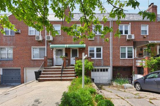 Town House Situated In R4 Zoning in Fresh Meadows. It Features 3 Bedrooms, 1.5 Bathroom, Hardwood floor, Full Basement And a Back Yard. Garage And Private Driveway. Near Mass Transit, Major Highways, Shops, Parks, Schools And All. A Must See!