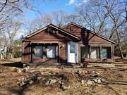 Calling all investors...3 Bedroom, 2 Full Bath Ranch on Large Lot. Full Unfinished Basement w High Ceilings and Outside Entrance. Cash or 203k Only.