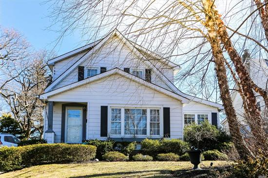 Charming 1920's Colonial features Hardwood Floors, Eat in Kitchen, 3 Bedrooms, 1.5 Bath, Formal Dining Room, Large Living Room, Den/Office.  Fenced Back Yard with 2 Car Garage, 2 Backyard Patios, great for entertaining!