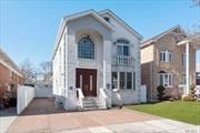 Bellerose Magnificent Colonial Home for Sale, Totally Renovated 4 Bedrooms, 3.5 Baths, Double Height Foyer & Windows, Living & Dining Rooms, Eat in Kitchen w/Stainless Steel Appliances & Custom Made Cabinets, Granite Countertops, Sliding Doors to Backyard Deck, Hardwood Floors, Crown Moldings Throughout, Full Finished Basement, Large Attic for Storage, Master Bedroom w/en Suite Bath w/Jacuzzi, Central Heat & A/C, Central Vacuum, Private Paved Driveway & Backyard, 1.5 Garage, Close to All. A Must See