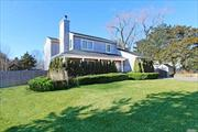 Private Beach & Boat Slip upon availabilty. Spacious East Quogue home offering master bedroom with bath plus 3 additonal bedrooms & 3 additional baths, living room with fireplace, den, dining area, kitchen with stainless appliances, full finished basement, CAC, fenced yard & more....