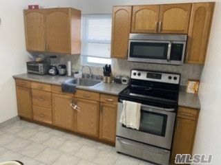 Nice, updated, bright two bedroom apartment on second floor. Close to LIRR and shopping. EiK, LR, full bath and 2 bedroom with double closets.No pets. Street parking.