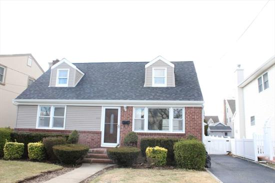 Recently updated home features New Roof, Siding, Gutters and much more. Home is centrally located in desirable Mineola. Five minutes away from both Mineola station as well as Williston Park. Close to everything