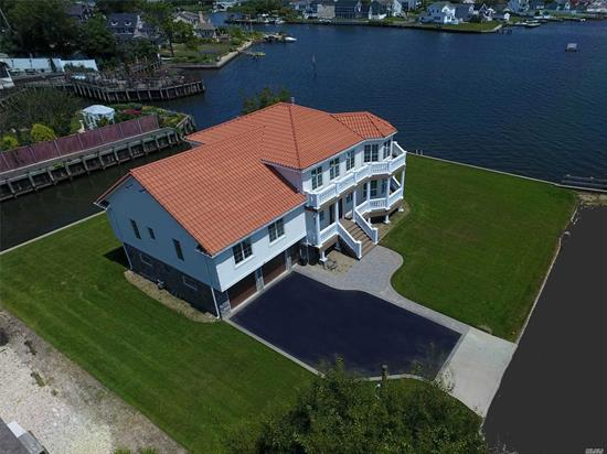 Stunning Waterfront, New Construction, Has Been Elevated 11 Feet & Built To Fema Codes. Mediterranean Style Residence Boasting Unobstructed Views Of The Great South Bay. White Oak Floors, Marble Counters, Viking & Subzero Apls, Dual Sided Fireplace, Elevator, Terracotta Roof, 248 Ft Of Bay & Canal Frontage. Approximate Flood Insurance Quote $724.00 For The Year!!