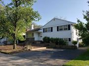 Move Right In Lovely 3/4 Bedroom Split Level Home In SD#15 In The Heart Of Woodmere. LR W/Fplc, Main Floor Large Den W/Skylights, Sliding Door To Lg Deck, 2 New Bathrooms, 2 Zone Heat, 5 A/C Units, New Dishwasher, HW Floors, Relatively New Roof, Freshly Painted, Close To Houses Of Worship.
