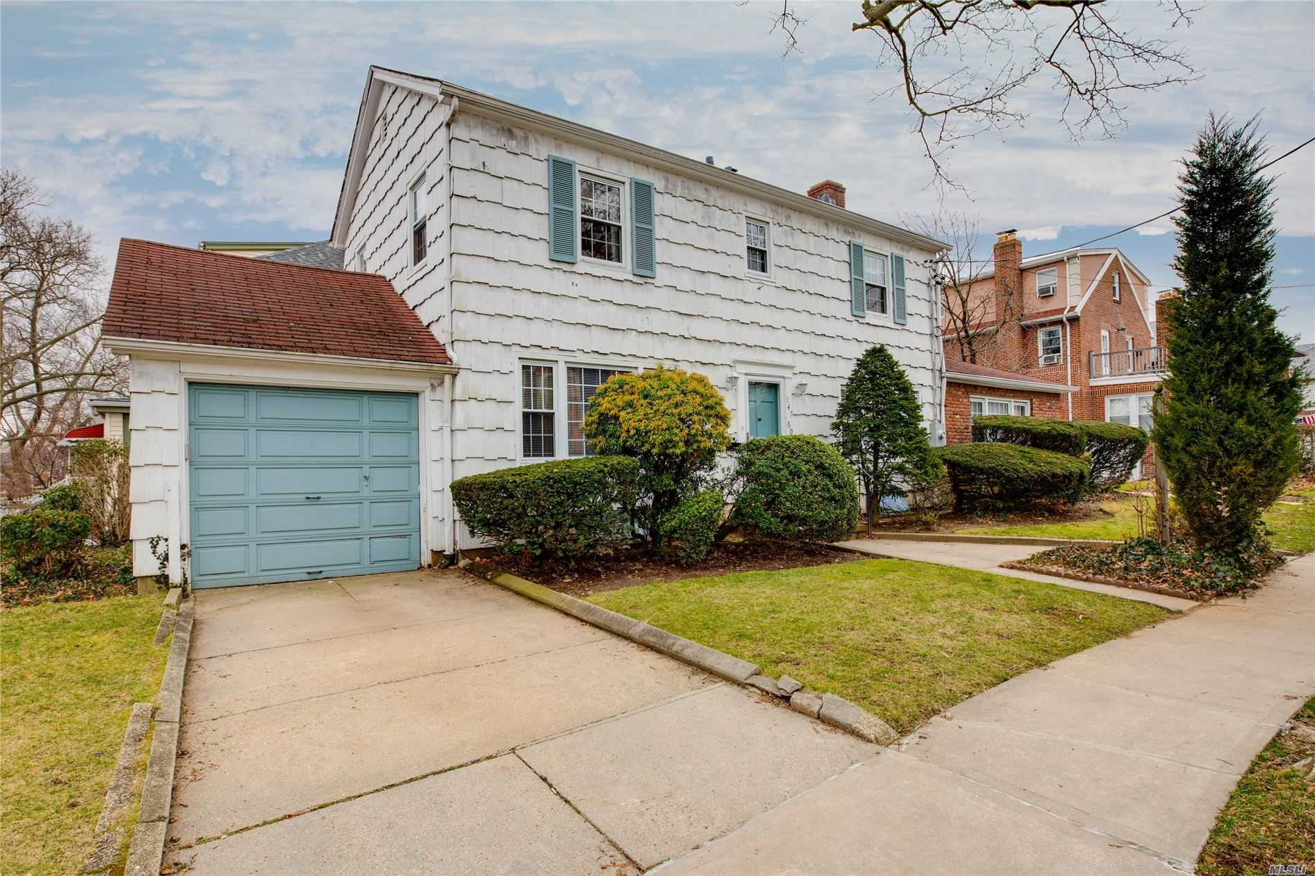 Welcome to this spacious center hall detached colonial located within the Kissena Park North neighborhood. The house receives an abundance of sunlight, has refinished oak wood floors and updated bathrooms. It is centrally located one block from the bus stop for the Q26 and Q27, one mile from the LIRR and 6 blocks from Kissena Park.