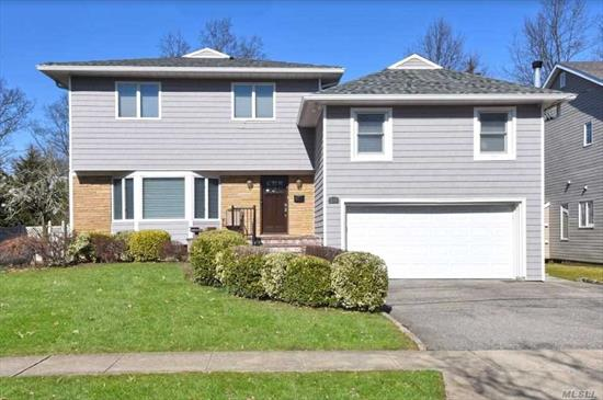 Expanded Custom Built Split Level Gem on private tree-lined st. + 3, 872 Sq Ft of living space. Home features High End details and finishes. Extra lrg rm, all redone Red Oak hardwood floors, large sun filled Eik, family rm W fireplace, extra large DR with a washing station and Lr with custom built in bookshelf. All over sized rms with great flow for entertaining. The lower flr features a Huge Den w half bth, 2nd flr features 2 maste lr. On Top Fl 4 bedrooms, F bath and laundry Rm. A Must See!!