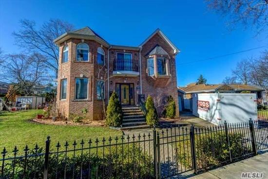 Gorgeous Brick, Custom Built & Young Colonial In Bayside! Featuring Beautiful Granite Entrance Foyer and Extra Wide Staircase. Large Formal Dining Rm with Special Fluted Moldings, Living Rm w/ Fireplace, Spacious Eat-In-Kitchen,  Large Bow Windows and Hardwood Floors Throughout. Master Ste W/ Walkin Closet & Balcony, 2 Bedroom Suites w/ Balconies, Laundry Room on 2nd Fl. Full Finished Basement w/ 10 ft Ceilings & Full Ba. Central Vac, Sprinkler System, 2 Driveways, 1 Car Garage & Landscaping