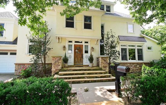 Sun-filled, gorgeous home for rent. Renovated In 2003. Beautiful entry foyer leading to gourmet chefs EIK + living rm. Formal dining rm overlooking deck w/sliders 2 private yard. 1/2 Bath. Walk-up to family rm or a br. Three addt'l brs including master br w/bath. 1 addt'l full bath w/washer + dryer. Hardwood flrs. Finished walk-up attic, huge! Basement for plenty of storage. Two car parking in driveway. Two car garage included for addt'l $250/mo. Walking distance to LIRR. Close to all.
