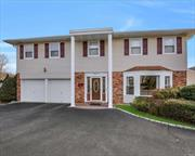 Looking for a REALLY big Brookfield Colonial in Kings Park on a 1/2 acre w/in-ground pool? This home has been extended, it has a huge kitchen and a banquet size dining room, in-ground pool, large basement with outside entrance, circular driveway, central air, fenced, fireplace, location is perfection, this home is awaiting your personal touches. There's no place like home.
