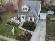 Beautiful expanded cape on over sized park lot property on dead end street. Updated kitchens and baths beautiful hardwood floors throughout home. Living rooms boasts wood burning fireplace too. Full finished basement with great additional living space along with a full bath.