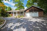 Large Expanded Ranch in Harborfields SD on 1/2 Acre of Flat, Fenced Property. Home Features 3 Bedroom, 2 Full Baths, LR/DR, Den w/Brick Wall Fpl, Large EIK w/Sliders to Deck. There is a Mudroom, Huge Basement & a Finished Loft Room Upstairs. Perfect for Storage.