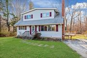 4 Bedroom 3 Full Bath Cape with Deck On .40 Acre Lot near Marratooka Pond. Close to Schools, Love Lane and Main Road. Perfect All Year Round or Vacation Home.